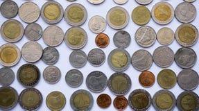 Moneda fijada al fondo Imagen de archivo