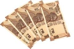 Moneda india 10 rupias en un backround blanco imagen de archivo