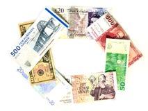 Moneda internacional como cadena Fotos de archivo libres de regalías