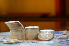 Moneda internacional y plata del libery que camina Imagen de archivo