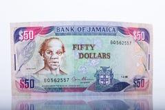 Moneda jamaicana, billete de banco de 50 dólares Imágenes de archivo libres de regalías