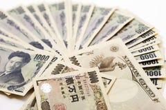 Moneda japonesa: mil billetes de banco de los yenes imagen de archivo libre de regalías