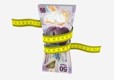 moneda mexicana 3D con los pares de tijeras Imagen de archivo libre de regalías