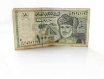 Moneda omaní del rial o del riyal en el fondo blanco Imágenes de archivo libres de regalías
