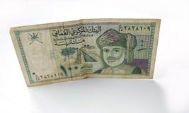 Moneda omaní del rial o del riyal en el fondo blanco Foto de archivo libre de regalías