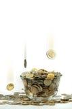 Moneda que cae Imagen de archivo libre de regalías