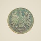 Moneda retra de la mirada aislada Imagen de archivo libre de regalías