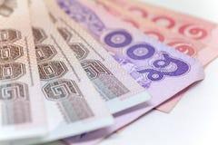 Moneda tailandesa en fondo y Imágenes de archivo libres de regalías