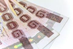 Moneda tailandesa en fondo y aislada Fotos de archivo libres de regalías