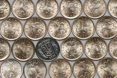 Moneda ucraniana entre las monedas rusas Foto de archivo libre de regalías