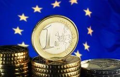 Moneda y bandera euro Imagen de archivo libre de regalías