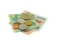 Moneda y billete de banco Imagen de archivo libre de regalías