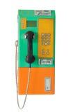 Moneda y tarjeta del teléfono público en el fondo blanco Fotografía de archivo libre de regalías