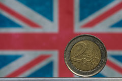 Moneda y Union Jack euro Fotografía de archivo libre de regalías