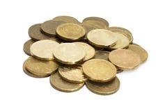Monedas aisladas en blanco Imágenes de archivo libres de regalías