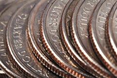 Monedas americanas cuartas Fotos de archivo libres de regalías
