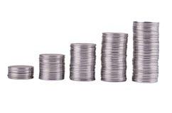 Monedas apiladas en el aumento Imágenes de archivo libres de regalías