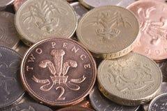 Monedas BRITÁNICAS Imágenes de archivo libres de regalías