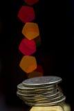 Monedas con el bokeh Fotos de archivo
