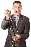 Monedas de colada del hombre de negocios rico feliz Foto de archivo libre de regalías
