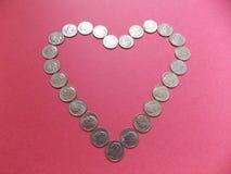 Monedas de diez centavos del amor foto de archivo