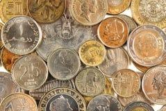 Monedas de diversos países Imagenes de archivo