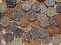 Monedas de libra en Londres Fotos de archivo
