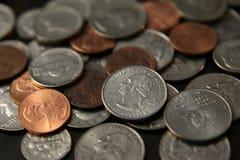 Monedas de los E.E.U.U. con el DOF bajo Fotografía de archivo