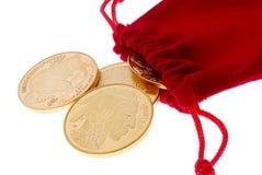 Monedas de oro Imágenes de archivo libres de regalías