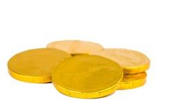 Monedas de oro aisladas Imágenes de archivo libres de regalías