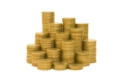 Monedas de oro aisladas en el fondo blanco Fotos de archivo