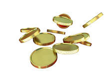 Monedas de oro aisladas en el fondo blanco Fotografía de archivo libre de regalías