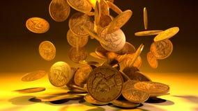 Monedas de oro que caen aisladas imagen de archivo