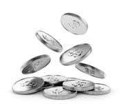Monedas de plata que caen Fotografía de archivo libre de regalías