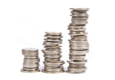 Monedas de plata viejas empiladas Foto de archivo libre de regalías