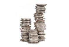 Monedas de plata viejas empiladas Imagen de archivo libre de regalías