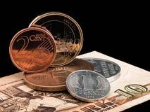 Monedas de RDA (RDA) y de la unión europea. Fotografía de archivo