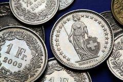 Monedas de Suiza imagenes de archivo