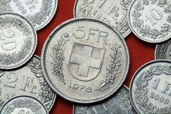 Monedas de Suiza Escudo de armas de Suiza imagenes de archivo