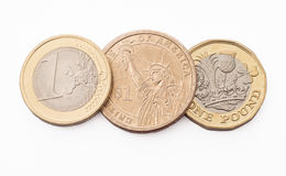 Monedas del dólar, del euro y de libra Imágenes de archivo libres de regalías
