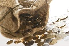Monedas del dinero en bolso Imagen de archivo