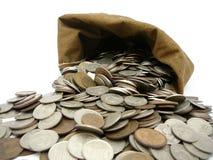Monedas del dinero en bolso Fotografía de archivo libre de regalías