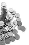 Monedas dispersadas fotografía de archivo