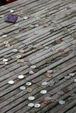Monedas donadas Imágenes de archivo libres de regalías