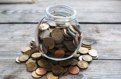 Monedas en botella Imagen de archivo libre de regalías