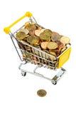 Monedas en carro de compras Imagenes de archivo