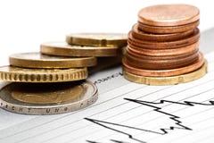 Monedas en carta Fotografía de archivo