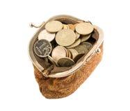 Monedas en el monedero del vintage Fotos de archivo