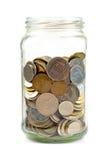 Monedas en el tarro de cristal Imagen de archivo libre de regalías