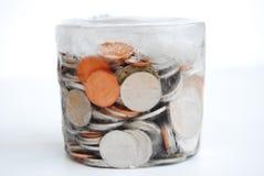 Monedas en hielo Imágenes de archivo libres de regalías